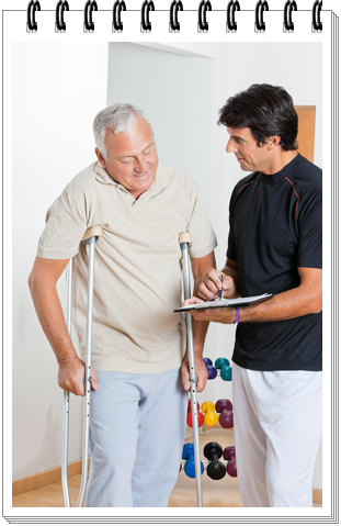 physical therapist helping MS patient